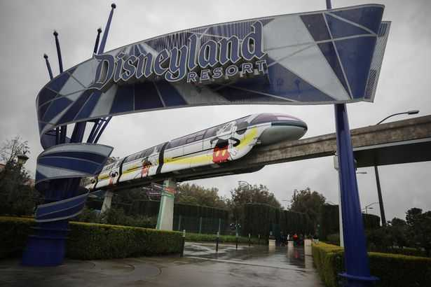 The monorail train runs on a track surrounding the theme park